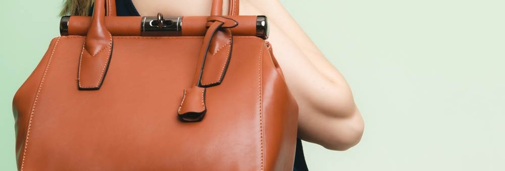Woman carrying a brown leather handbag