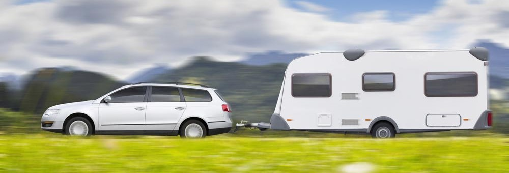 Car and Caravan driving in the countryside