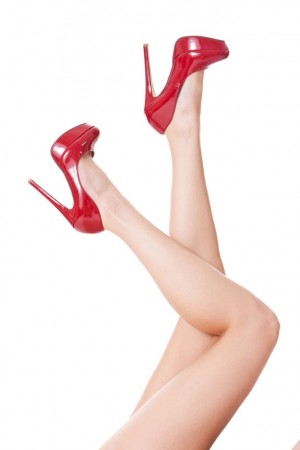 Ladies legs pointing upwards with red shoes