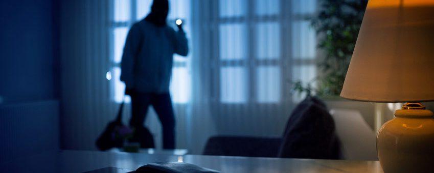 Home burglar at night
