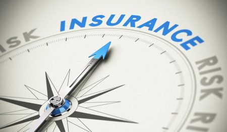Compass needle pointing the word insurance. Concept image blue and beige tones